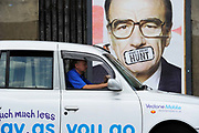 A taxi passes a poster signed by street artist Dr. D showing a portrait of News Corp head Rupert Murdoch in London. Britain's Culture Secretary Jeremy Hunt referred News Corporation's bid for BSkyB to the Competition Commission.