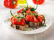 Roast red peppers with padron pepperson toasted rye bread sandwiches - bruschettas.