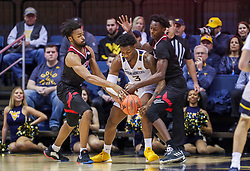 Dec 14, 2019; Morgantown, WV, USA; West Virginia Mountaineers forward Gabe Osabuohien (3) dribbles while defended by Nicholls State Colonels guard Lorenzo McGhee (14) and Nicholls State Colonels forward Warith Alatishe (25) during the first half at WVU Coliseum. Mandatory Credit: Ben Queen-USA TODAY Sports
