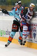 24.03.2011, Rapperswil-Jona, Eishockey NLA Playout, Rapperswil-Jona Lakers - HC Ambri-Piotta, Reto Suri (l, LAK) gegen Marc Schulthess (AMB)  (Thomas Oswald/hockeypics)