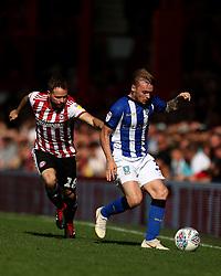 Sheffield Wednesday's Fraser Preston and Brentford's Alan Judge in action