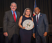 Sandra Menxueiro, center, accepts an award for the Farias  Early Childhood Center Garden from Daniel Sullenbarger, left, and Sylvester Turner, right, during the Keep Houston Beautiful Mayor's Proud Partner Awards luncheon at the Hilton Americas, November 7, 2016.