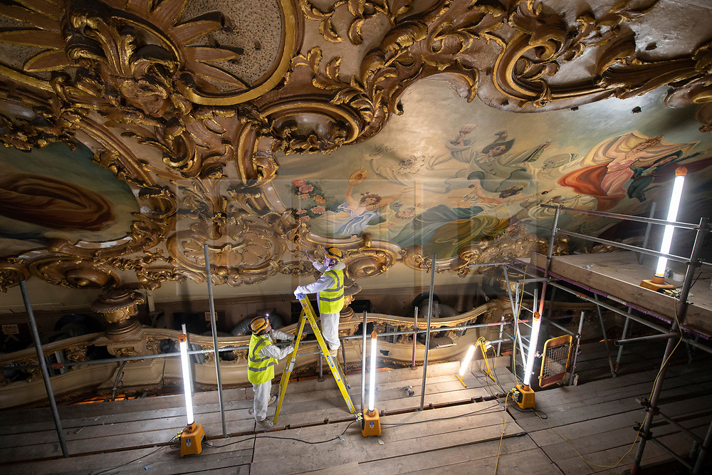 IMAGES SHOT ON APRIL 20TH 2021 © Licensed to London News Pictures. 12/05/2021. Blackpool, UK. Specialist painters and fibrous plasterers work on the major conservation project taking place in the Tower Ballroom, in Blackpool, Lancashire on April 20, 2021. The Blackpool Tower Ballroom, located in the Grade 1 Listed Tower and which dates back to 1894, has undergone the most extensive programme of work and deep clean for more than 60 years totaling £1.1M. A team of skilled, specialist craftsmen, who have worked across the world on projects including the Queen's Gallery at Buckingham Palace, have dedicated more than 21,000 hours, over a period of six months, to restore the famous Ballroom to its original glory. Due to the Coronavirus pandemic the ballroom has now been closed for over 12 months and is scheduled to re-open to the public on June 21, 2021. Photo credit: Oli Scarff/LNP