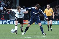 Champions League 01.11.05 - RBK - Real Madrid 0-2<br /> <br /> Roar Strand gets a push by Sergio Ramos<br /> Foto: Carl-Erik Erikson, Digitalsport