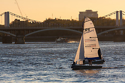 Battersea, London, April 29th 2015. After a day that started off with gloomy, damp weather, Londoners are rewarded with a beautiful spring sunset. PICTURED: A sailboat tacks its way across the River Thames as the sun gets lower in the sky.
