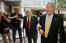 10 June  2015. New Orleans, Louisiana. <br /> Tom Benson (mid), billionaire owner of the NFL New Orleans Saints, the NBA New Orleans Pelicans, various auto dealerships, banks, property assets and a slew of business interests arrives at New Orleans Civil District Court with his attorney Phillip Whitman where they are attending a hearing to determine Benson's level of competency to manage his business empire. Benson changed his succession plans and  decided to leave the bulk of his estate to third wife Gayle, sparking a controversial fight over control of the Benson business empire.<br /> Photo©; Charlie Varley/varleypix.com