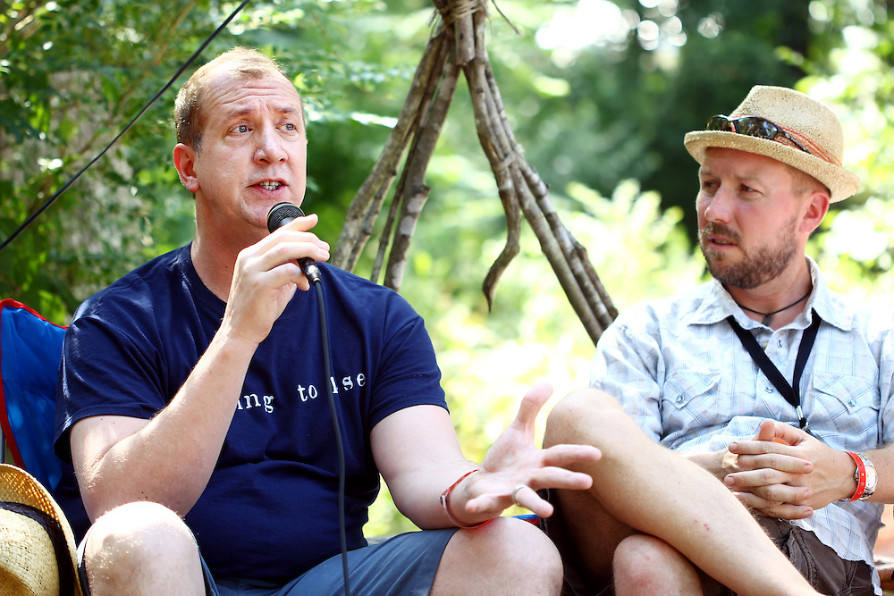 Paul Fromberg, left, Rector at St. Gregory of Nyssa Episcopal Church in San Francisco, participates in a conversation on sexuality and spirituality in the geodesic dome at the Wild Goose Festival at Shakori Hills in North Carolina June 24, 2011.  (Photo by Courtney Perry)