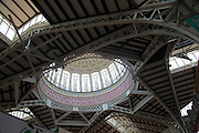 Inside central market building, city of Valencia, Spain glass domed roof