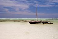 A dhow on Kiwendwa Beach at low tide.  Zanzibar, Tanzania