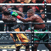Luis Ortiz throws a left hand to the head of Deontay Wilder during the WBC Heavyweight Championship boxing match at Barclays Center on Saturday, March 3, 2018 in Brooklyn, New York. Wilder would win the bout by knockout in the tenth round to retain the title and move to 40-0. (Alex Menendez via AP)