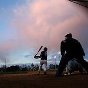 Keegan Roberts, McMahon Senators, hits a pitch during an early evening  High School Baseball ball game between St. Joseph (Trumbull, CT) and McMahon Senators at Brien McMahon High School. Norwalk, Connecticut. USA. 14th May 2013. Photo Tim Clayton