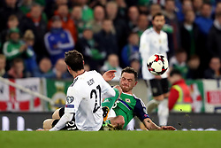 Northern Ireland's Corry Evans and Germany's Sebastian Rudy (left) battle for the ball during the 2018 FIFA World Cup Qualifying, Group C match at Windsor Park, Belfast.