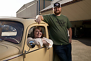 Couple with their custom Volkswagen Bug.