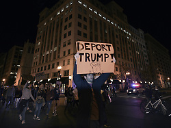November 10, 2016 - Washington, District of Columbia, U.S. - Protests erupt over 2016 Presidential election results in Washington DC with Donald Trump winning over Hillary Clinton. Clinton supporters take to the streets, stopping at Trump hotel, the White House and Capitol.  'This is the revolution,' they declared. (Credit Image: © Carol Guzy via ZUMA Wire)