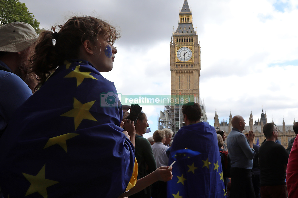 September 9, 2017 - London, United Kingdom - A girl wrapped in an EU flag stands in Parliament Square Garden in Westminster, central London, during the People's March for Europe, an anti-Brexit rally, on 9 September 2017. The clock tower of Big Ben is in the background. (Credit Image: © Dominic Dudley/Pacific Press via ZUMA Wire)