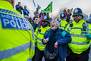 The police start issuing section 14 public order act warnings to a 70+ year old woman, and then she is arrestedto cheers of support from the crowd - Waterloo bridge is turned into a garden bridge - Protestors from Extinction Rebellion block several (Hyde Park, Oxford Circus, Piccadilly Circus, Warterloo Bridge and Parliament Square) junctions in London as part of their ongoing protest to demand action by the UK Government on the 'climate chrisis'. The action is part of an international co-ordinated protest.