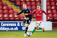 Ali Crawford battles for possession with Liam Kinsella of Walsall   during the EFL Sky Bet League 2 match between Walsall and Tranmere Rovers at the Banks's Stadium, Walsall, England on 13 April 2021.