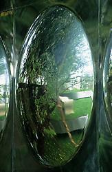 Detail shot of aluminium disk reflecting garden. Design Diarmuid Gavin