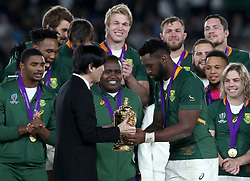 Japan Crown Prince Akishino (left) hands the Webb Ellis Cup to South Africa's Siya Kolisi during the 2019 Rugby World Cup final match at Yokohama Stadium.