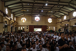 August 26, 2017 - Manila, Philippines - Sympathizers of Kian Delos Santos attend his funeral at a church in Manila, Philippines on Saturday, August 26, 2017. Kian Loyd Delos Santos, a 17 year old high school student who was killed by policemen in an alleged shootout, has become a rallying point for activists and opponents of President Rodrigo Duterte to criticize the bloody war on drugs in the Philippines, which has claimed at least 7,000 lives and arresting more than 90,000, according to official data. (Credit Image: © Richard James Mendoza/NurPhoto via ZUMA Press)