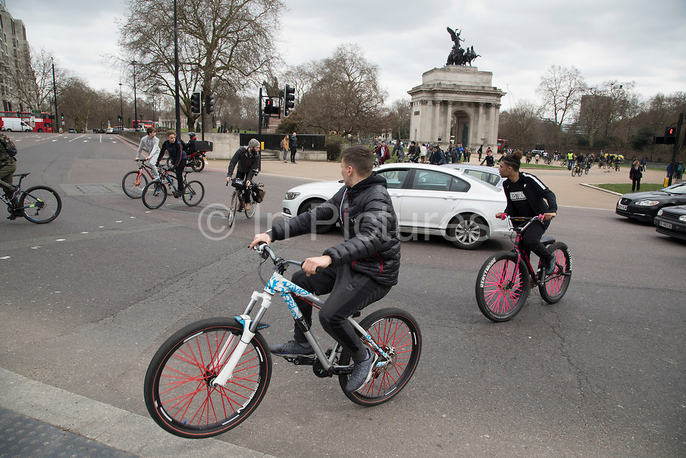 Thousands of cyclists from Bike Life, many with fat tyre bikes on a mass ride-through block the street and wheelie their cycles around Hyde Park Corner in London, United Kingdom. This was like a flash mob event, where suddenly the whole street was filled with bicycles that took over the streets.