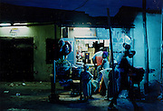 On a street at night, in Lomé, Togo.