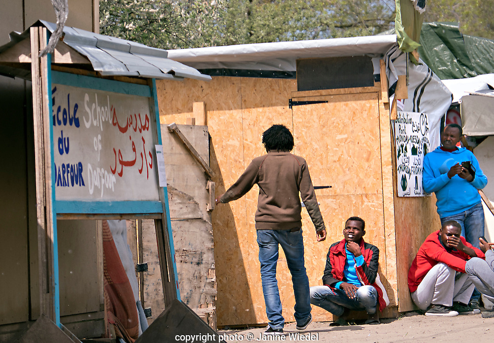 Sudanese Refugees waiting for the school of Darfour to open in The Calais Jungle Refugee and Migrant Camp in France