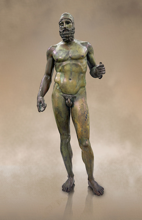 Full length face on view of the Riace bronze Greek statue B cast about 460 - 450 BC. statue B was probably sculpted by Phidias. There is a sense of movement in the statues their legs being bent as if they are about to take a step. Their heads are turned which accentuates a sense of anticipation as if they are looking for something. The anatomical detail is extraordinary which gives a startling realism to the statue and demonstarte the high level of skill of the Greek sculptors of this peiod. Museo Nazionale della Magna Grecia,  Reggio Calabria, Italy.  .<br /> <br /> If you prefer to buy from our ALAMY STOCK LIBRARY page at https://www.alamy.com/portfolio/paul-williams-funkystock/greco-roman-sculptures.html . Type -    Riace     - into LOWER SEARCH WITHIN GALLERY box - Refine search by adding a background colour,  etc.<br /> <br /> Visit our ROMAN WORLD PHOTO COLLECTIONS for more photos to download or buy as wall art prints https://funkystock.photoshelter.com/gallery-collection/The-Romans-Art-Artefacts-Antiquities-Historic-Sites-Pictures-Images/C0000r2uLJJo9_s0