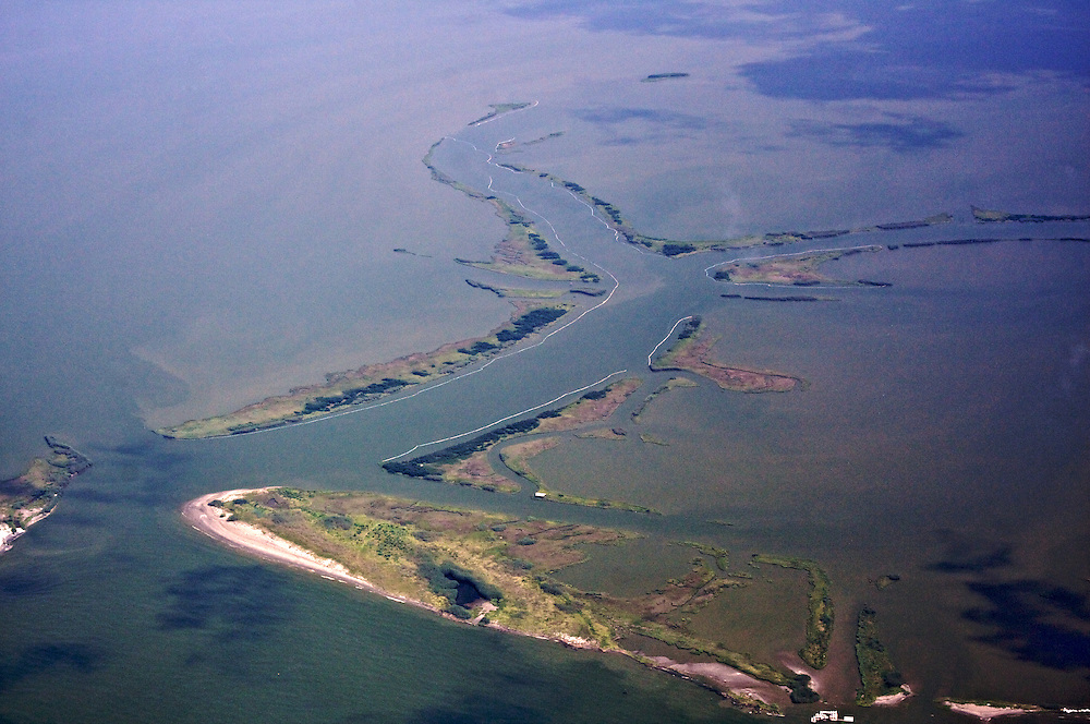 Scofield Bayou, lined with oil boom, Plaquemines Parish, Louisiana, USA
