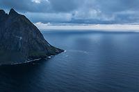 Mountain peak rises from sea as viewed from Ryten, Lofoten Islands, Norway