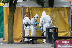 © Licensed to London News Pictures . 03/05/2019. Manchester, UK. Forensic examiners at the scene . Police have cordoned off several square blocks around Piccadilly Gardens in Manchester City Centre following concern that a device . A tent has been erected and a man has been arrested in connection with the incident . Oldham Library has also been evacuated on what is believed to be a connected incident . Photo credit: Joel Goodman/LNP