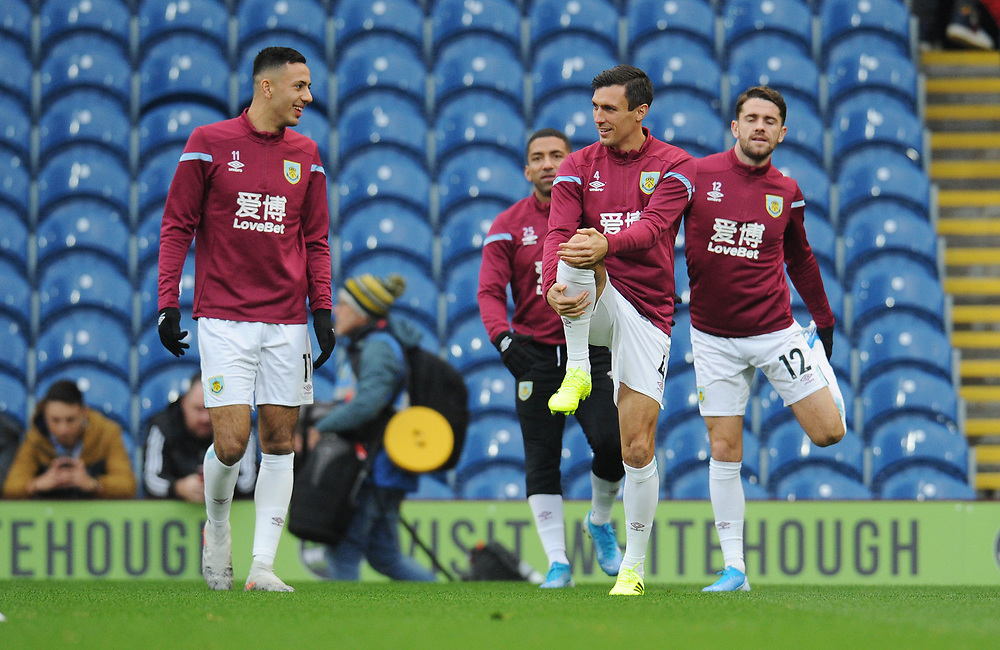 Burnley's Dwight McNeil, Aaron Lennon, Jack Cork and Robbie Brady during the pre-match warm-up <br /> <br /> Photographer Kevin Barnes/CameraSport<br /> <br /> The Premier League - Burnley v Chelsea - Saturday 26th October 2019 - Turf Moor - Burnley<br /> <br /> World Copyright © 2019 CameraSport. All rights reserved. 43 Linden Ave. Countesthorpe. Leicester. England. LE8 5PG - Tel: +44 (0) 116 277 4147 - admin@camerasport.com - www.camerasport.com