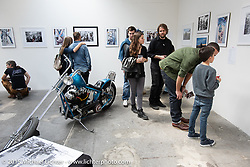 Checking out Michael Lichter's photographs in the Art and Wheels art and motorcycle show in the M45 gallery in Basel, Switzerland. May 16, 2015. Photography ©2015 Michael Lichter.