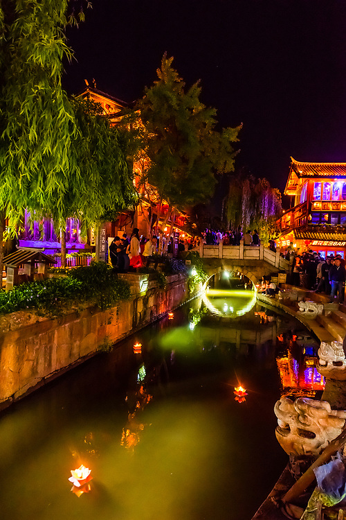 Candle boats being floated down a canal near the Old Stone Bridge, Dayan (The Old Town), Lijiang, Yunnan Province, China. The Old Town is a UNESCO World Heritage Site.