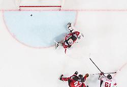 Fabrice Herzog of Switzerland scoring third  - winning goal for Switzerland against Calvin Pickard of Canada during the 2017 IIHF Men's World Championship group B Ice hockey match between National Teams of Canada and Switzerland, on May 13, 2017 in AccorHotels Arena in Paris, France. Photo by Vid Ponikvar / Sportida