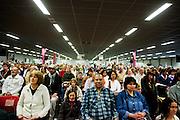 Voor de darshan, oftewel omhelzing, begint mediteren de bezoekers samen met Amma. In de Expo in Houten is Mata Amritanandamayi, beter bekend als Amma of 'hugging mother', aanwezig om mensen te omhelzen en te inspireren. Het driedaags benefiet in Houten is het grootste spirituele festival in Nederland en zal naar verwachting 15.000 bezoekers trekken.<br /> <br /> Before the start of the darshan there is a moment of meditation. In the Expo in Houten people are gathering to get a darshan, or hug, by  Mata Amritanandamayi, also known as Amma or 'hugging mother'. Amma is travelling through the world to hug people for inspiring them to make a better world. Amma is one of the twelve most influence spiritual leaders of the world. The event in Houten lasts for three days and is the biggest spiritual event of The Netherlands.