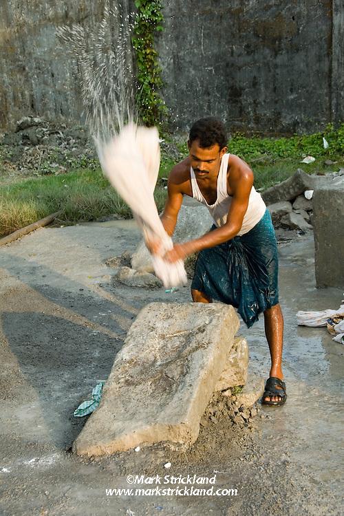 Doing laundry, native style. Port Blair, Andaman Islands, India