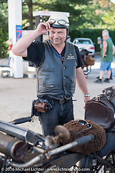 Andreas Kaindl of Germany at a gas stop with his 1913 Henderson during the Motorcycle Cannonball Race of the Century. Stage-1 from Atlantic City, NJ to York, PA. USA. Saturday September 10, 2016. Photography ©2016 Michael Lichter.