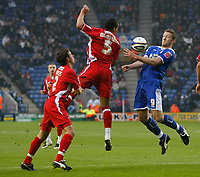 Photo: Steve Bond/Richard Lane Photography. Leicester City v Leyton Orient. Coca Cola League One. 10/01/2009. Steve Howard (R) brings the ball down on his chest as (C)  Tamika Mkandawire challanges. Stephen Purches (L) looks on