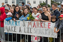 Crowds await the arrival of the Duke and Duchess of Sussex to view the newly unveiled UK war memorial and visit Pukeahu National War Memorial Park, in Wellington, on day one of the royal couple's tour of New Zealand.