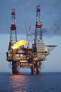 Alaska. Cook Inlet. Gas production platform, crew changes are routinely done by helicopter.