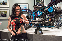 Custom builder Nikki Martin shows off her tattoo that inspired her build for the Old Iron - Young Blood exhibition during the media and industry reception in the Motorcycles as Art gallery at the Buffalo Chip during the annual Sturgis Black Hills Motorcycle Rally. Sturgis, SD. USA. Sunday August 6, 2017. Photography ©2017 Michael Lichter.