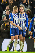 Davy Propper (Brighton) celebrates his goal with Adam Webster (Brighton) to give Brighton a 2-1 lead during the Premier League match between Brighton and Hove Albion and Wolverhampton Wanderers at the American Express Community Stadium, Brighton and Hove, England on 8 December 2019.