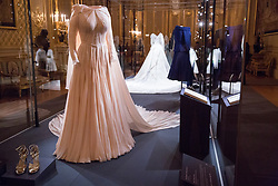 Windsor, UK. 28th February, 2019. The evening gown of HRH Princess Eugenie by American designer Zac Posen which will go on display with other items of the wedding outfits of the Princess and Mr Jack Brooksbank at Windsor Castle in a special exhibition named 'A Royal Wedding: HRH Princess Eugenie and Mr Jack Brooksbank' from 1st March to 22nd April. The highlights of the exhibition include Princess Eugenie's wedding dress created by Peter Pilotto and Christopher De Vos of the British-based label Peter Pilotto, the Greville Emerald Kokoshnik Tiara, on public display for the first time, two diamond wheat-ear brooches lent by Her Majesty the Queen, diamond and emerald drop earrings gifted to the bride by the groom, Mr Jack Brooksbank's morning suit made by tailors at Huntsman on Savile Row, HRH Princess Beatrice's blue dress by the London-based couture house Ralph & Russo and headpiece by British milliner Sarah Cant and a bridesmaid and pageboy outfit by London-based children's designer Amaia Kids.
