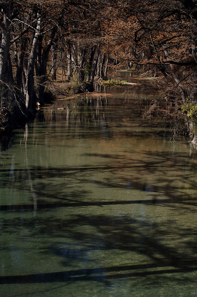 Stock photo of a quiet afternoon on a still section of river in the Texas Hill Country