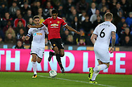 Marcus Rashford  of Manchester United © breaks away from Angel Rangel of Swansea city. . EFL Carabao Cup 4th round match, Swansea city v Manchester Utd at the Liberty Stadium in Swansea, South Wales on Tuesday 24th October 2017.<br /> pic by  Andrew Orchard, Andrew Orchard sports photography.