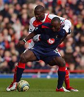 Photo: Daniel Hambury, Digitalsport<br /> Arsenal v Portsmouth.<br /> FA Barclays Premiership.<br /> 05/03/2005.<br /> Arsenal's Lauren and Portsmouth's Lualua battle for the ball.