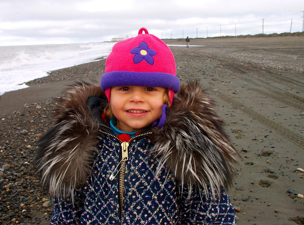 Barrow, Alaska. Juliana Aikins wearing a parka at the beach.