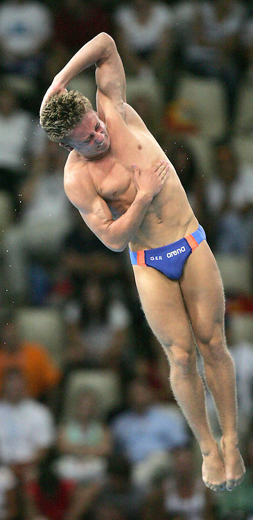 Tony Adam from Germany preforms during the Mens 10m Platform Diving preliminary at the Olympic Aquatic Centre in Athens Friday 27 August 2004.    (Photo by Patrick B. Kraemer / MAGICPBK)