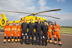 The Duke of Cambridge Poses for a final photo with both day and night shift crews as he starts his final shift with the East Anglian Air Ambulance based at Marshall Airport near Cambridge. (left to right) CCP Gary spitzer, Dr Karen rhodes, Dr Adam Chesters, Prince William, Cpt Matt Sandbach, Cpt Dave Kelly, Pilot Olly Gates, Dr Tobias Gouse and CcpCarl Smith.